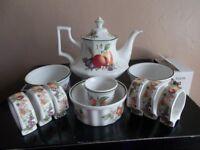 Tea pot .ramekin dishes and serviette rings