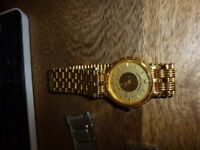 watch with 18k crown
