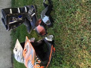 2 Dirt Bike Helmets, 1 pair of Dirt bike Boots