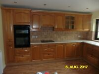 Used oak kitchen units, De Dietrich induction hob (4 years old) and NEFF double oven.