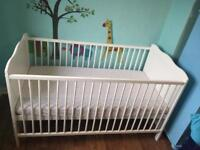 Cotbed - can be converted to toddler bed. Include mattress never used and 2 mattress fitted sheet