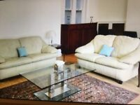 A 3 seater and a 2 seater cream coloured sofa set in immaculate condition