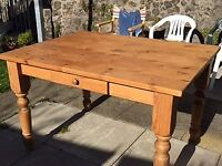 Solid pine kitchen table - used but still going strong