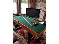 Good solid pool table & balls & Cues ..foldable ease of storage