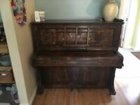 Lovely old piano in working order. Must be able to collect.