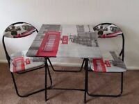 London themed square folding table and two folding chairs