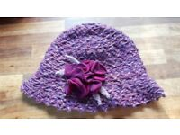 Coccinelle elegant hat with flowery motive attached. New, without tag