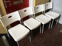 Lovely set of 4 white chairs