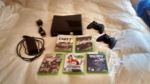 xbox 360 with 2 controllers, cables, plus 5 games