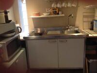 IKEA student kitchen unit, with fridge, sink, and hob.