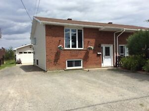 2 bedroom semi with a large garage turn key
