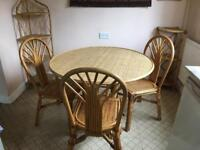 Wicker Dining table and 3 chairs plus shelving