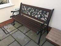 Wrought iron and wooden garden bench