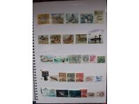 Wildlife stamp album packed with 100s of stamps featuring animals, birds,fish etc.(see all photos)