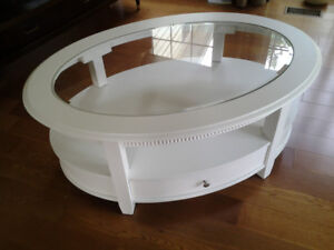 White oval glass top coffee table