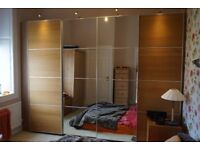2 fitted Pax wardrobes with sliding doors