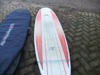"7'2"" Magic Carpet Surf Board."