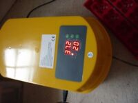 12 egg incubator, new, just switched on to test.
