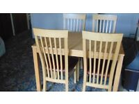 Dining Table and Four Chairs - light Oak finish - Ex Costco - odd slight mark from use.