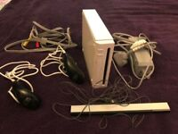 Nintendo Wii console & sensor bar with nunchuck controllers