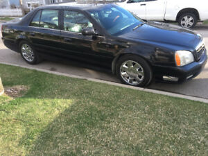 2001 Shiny Black Cadillac DTS Sedan