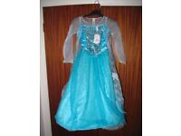 Frozen Elsa costume with gloves Disney with orginal labels for 7 to 8 years old, price new £40