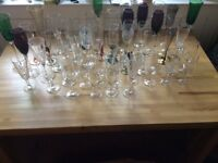 Eclectic mix of champagne glasses perfect for weddings and parties, also wine glasses, glass cleaner