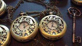 Assorted pocket watches and keys