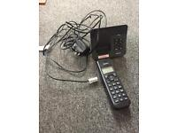 Wireless phone with answer machine