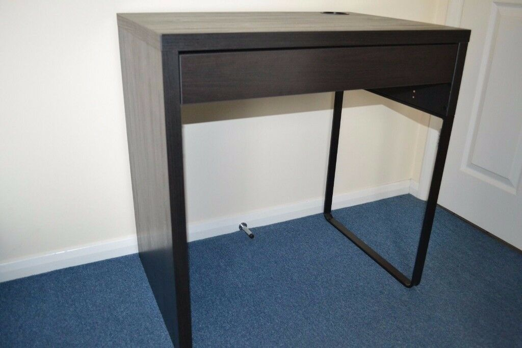IKEA Micke Desk TABLE (AS NEW conditionin Wallington, LondonGumtree - Used but in VERY good condition IKEA Micke Desk Black brown. Assembled and very sturdy. Key features It's easy to keep sockets and cables out of sight but close at hand with the cable outlet at the back. You can mount the legs to the right or left,...