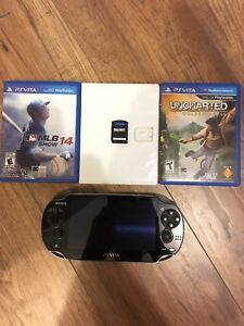 PS Vita with memory card and games