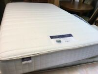 A SMALL4' DOUBLE PINE BED FRAME WITH A SILENT NIGH MATTRESS