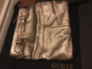 Authentic Guess gold hand bag