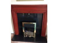 Traditional brass electric fire, dark wood mantle and marble hearth