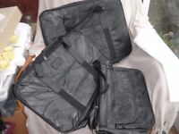 Pair black leather fold flat suitcases + extra