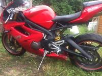 Triumph Daytona 765 in red 7991 on clock