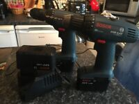 2 x Bosch cordless drills with charger and 3 batteries