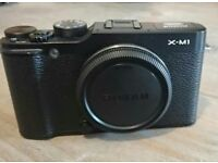 Fuji x-m1 excellent condition + spare batteries and remote release