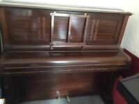 Upright piano, in good condition, needs tuning. Great for beginners