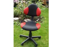 A Small Office/Computer Chair on Five Toe Pedestal with castors.