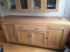 Solid oak sideboard four doors and one central drawer