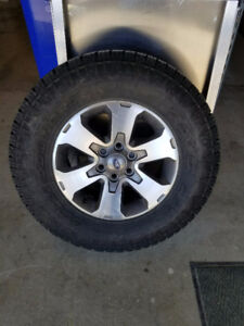 4 - near new Mud and Snow tires and mags