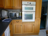 A kitchen including double oven and gas hob