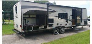 31 foot light weight tag-along trailer. Outside kitchen