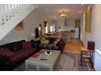 Beautiful master bedroom in 2 bedroom period coach house - dog included