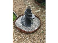 A slate unique designed garden ornament