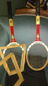 Pair of wooden tennis racquets stored properly