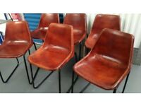 Six Vintage Leather Look Industrial Chairs
