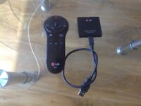 Lg smart tv original magic remote and dongle.