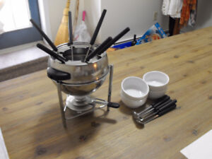 Fondue pot with 12 new forks and dishes for sauces
